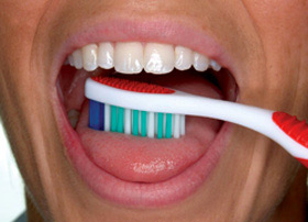 Brush your tongue to remove bacteria and freshen your breath.